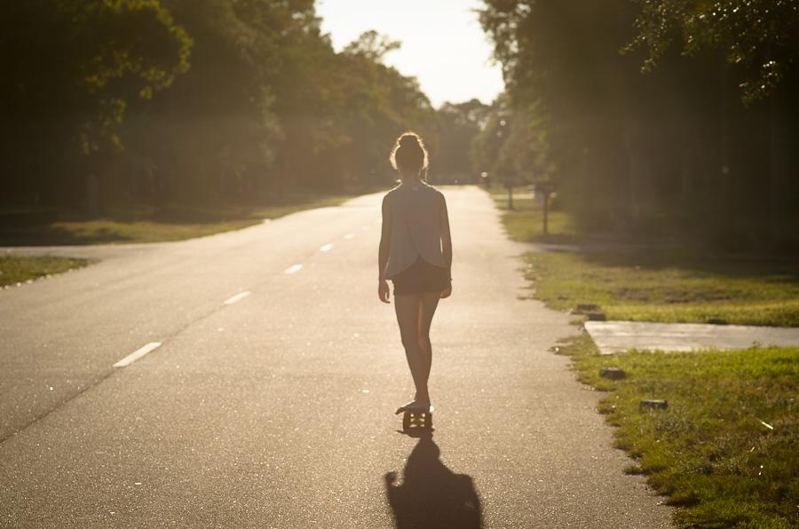 Riding her skateboard
