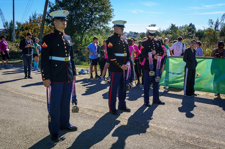 Marines with medals for runners