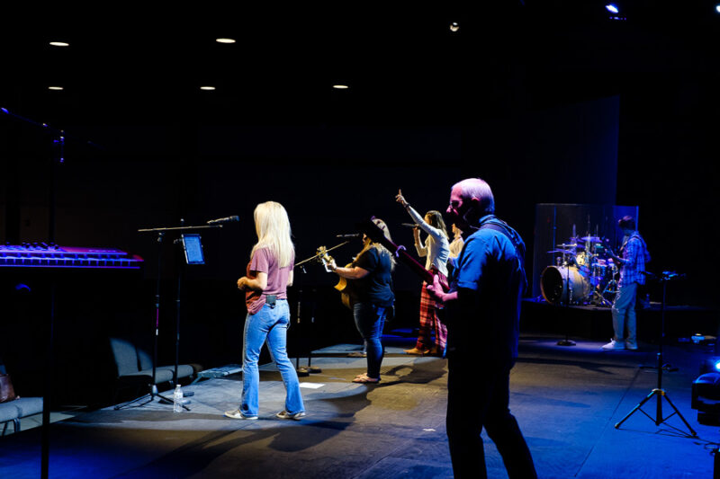 A photo from the back corner of stage left while the praise team on stage.