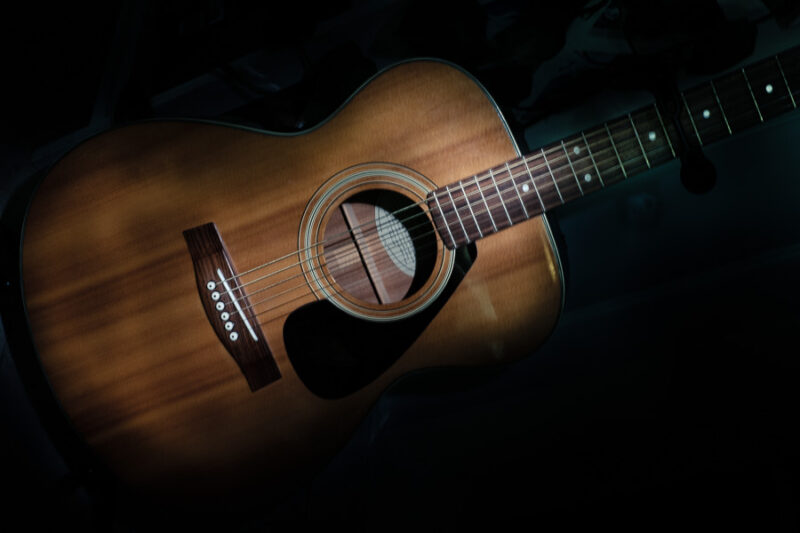 A guitar light with a flash light at a slow shutter speed.