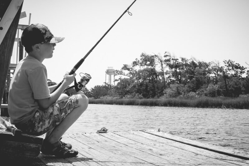 Boy fishing on a dock.