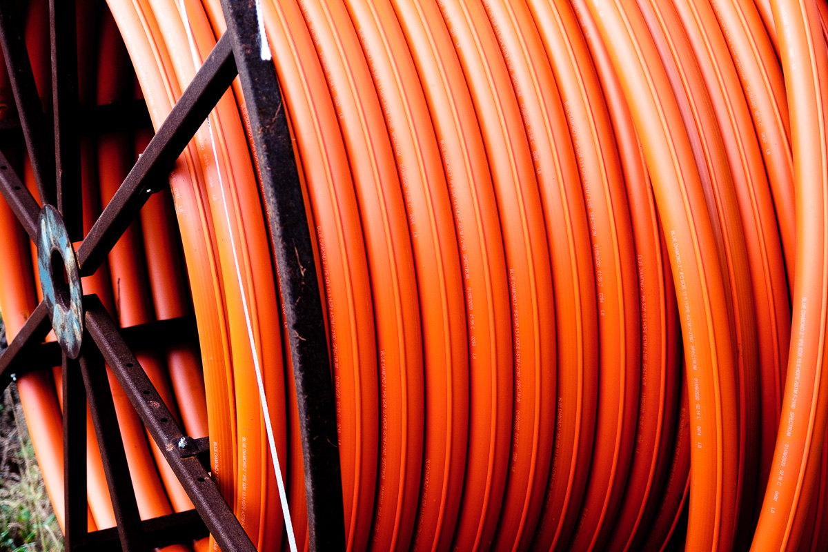 Orange spool of conduit