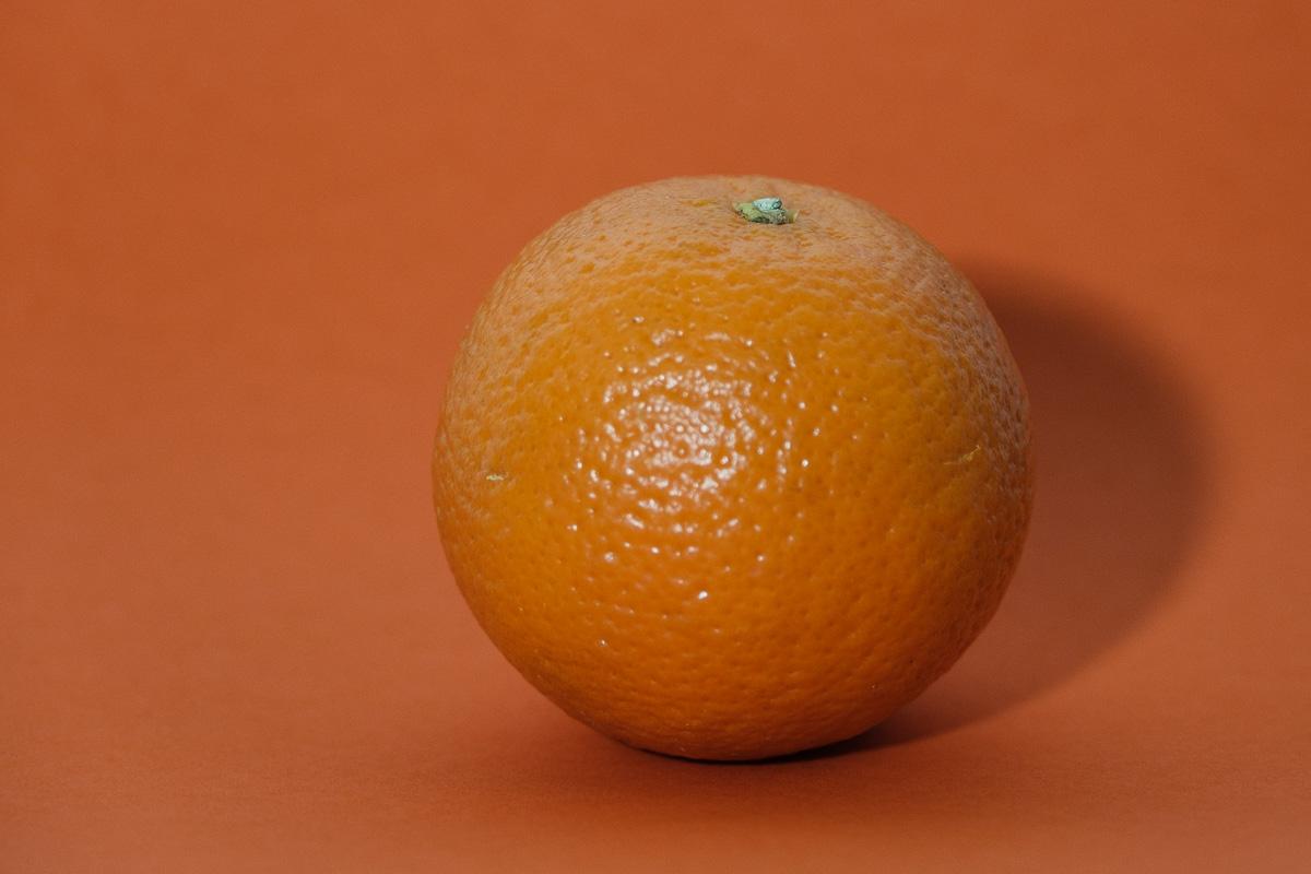 An Orange on an orange background