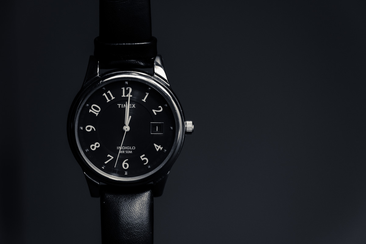 Analog watch just past midnight on the New Years day