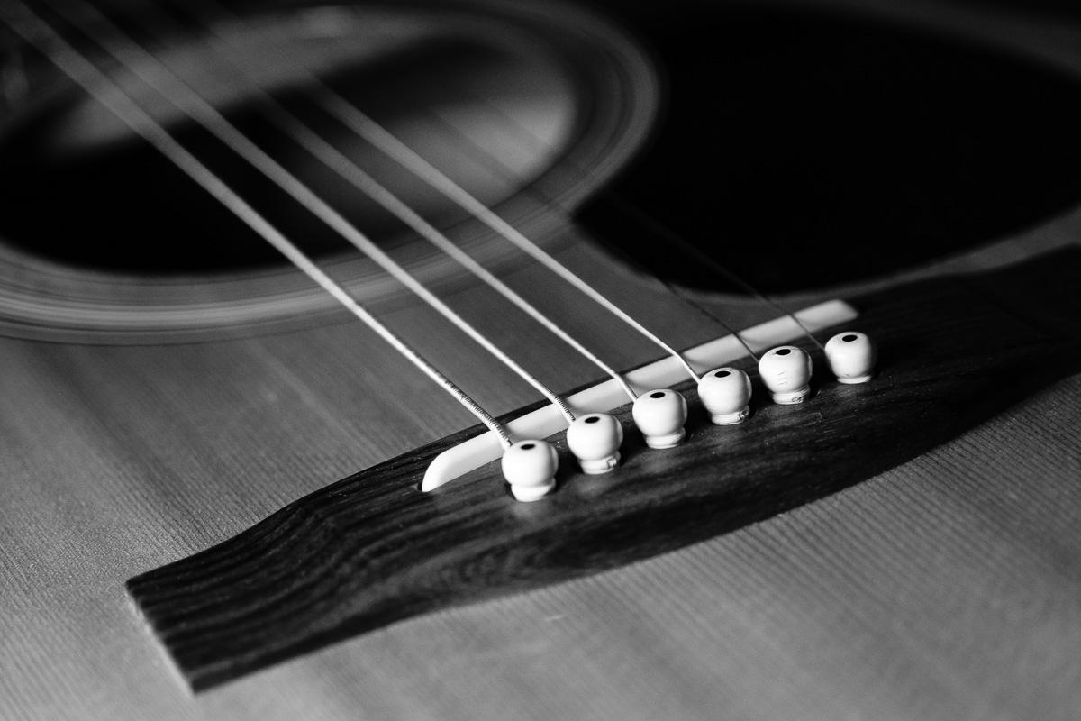Black and white photo of a guitar bridge