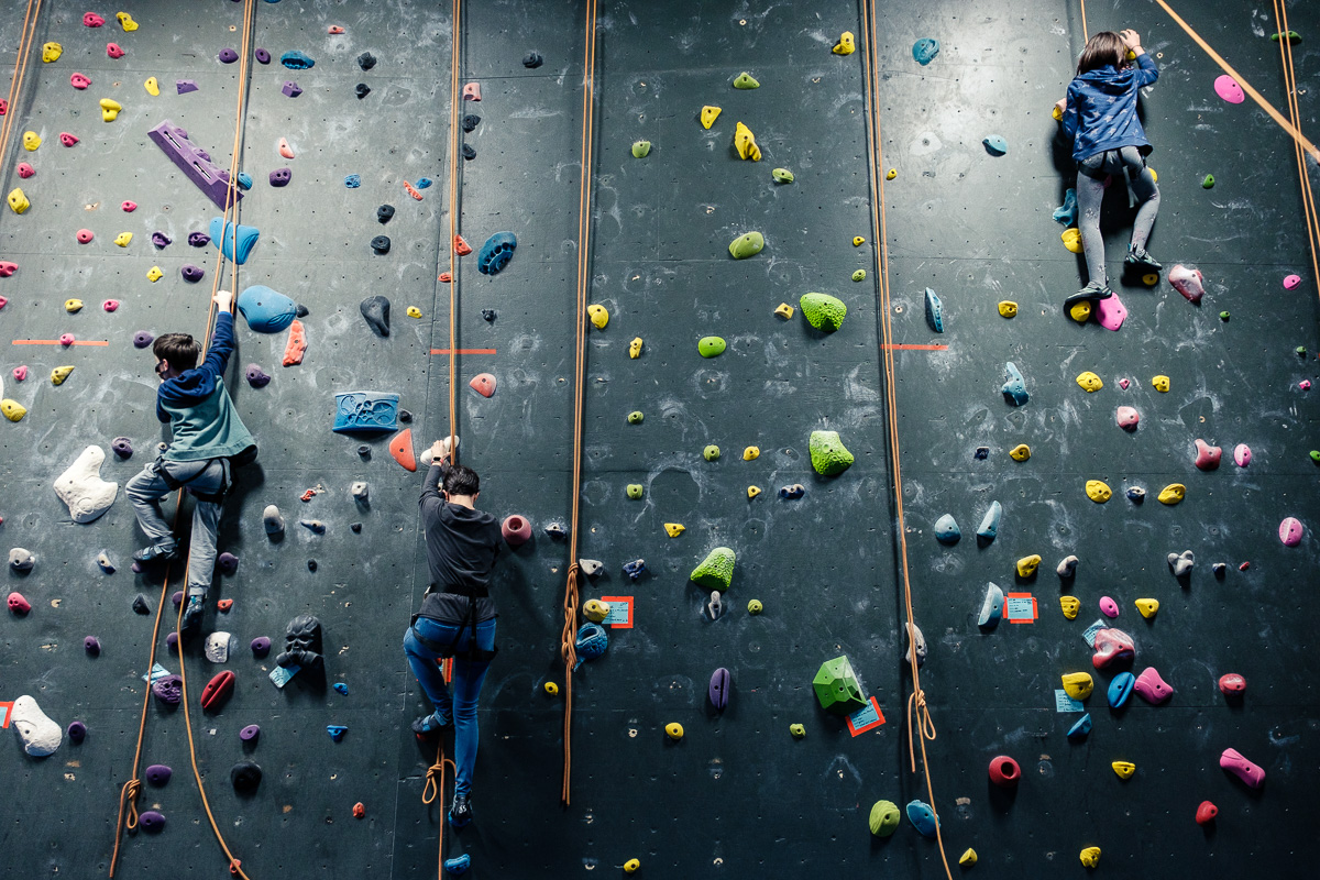 Rocking Climbing wall with climbers on it.